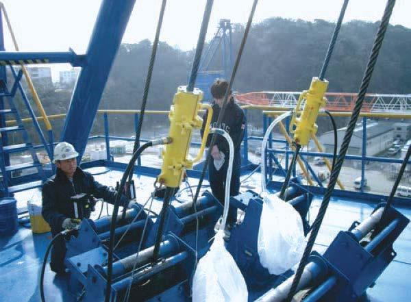 Yokosuka Naval Base Base. Twin SU35B Wire Rope Lubricators used on barge crane.